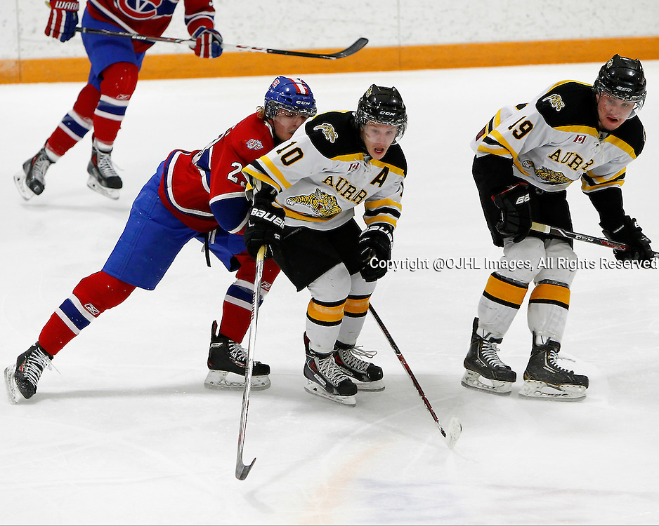 AURORA, ON - Mar 13, 2015 : Ontario Junior Hockey League game action between the Kingston Voyageurs and the Aurora Tigers.  Game one of the best of the Semi-Final series, Drake Board #10 battles for the puck in the first period.<br /> (Photo by Brian Watts / OJHL Images)