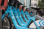 Divvy bike share stand in the Loop district Chicago USA