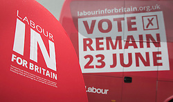 © Licensed to London News Pictures. 10/05/2016. London, UK. A supporter holds a rain soaked umbrella in front of a new campaign bus as Labour Party leader Jeremy Corbyn and Alan Johnson, Chairman of 'Labour In for Britain' unveil their EU referendum campaign.  Labour deputy Tom Watson and Gloria De Piero, Shadow Minister for Young People and Voter Registration, also attended. Photo credit: Peter Macdiarmid/LNP