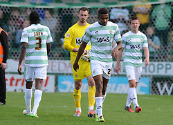 Dejection for Yeovil Town players as they are relegated to League Two. - Photo mandatory by-line: Harry Trump/JMP - Mobile: 07966 386802 - 11/04/15 - SPORT - FOOTBALL - Sky Bet League One - Yeovil Town v Notts County - Huish Park, Yeovil, England.