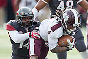LITTLE ROCK, ARKANSAS - NOVEMBER 23:  Eric Bennett #14 of the Arkansas Razorbacks tackles Jameon Lewis #4 of the Mississippi State Bulldogs at War Memorial Stadium on November 23, 2013 in Little Rock, Arkansas.  The Bulldogs defeated the Razorbacks 24-17.  (Photo by Wesley Hitt/Getty Images) *** Local Caption *** Jameon Lewis; Eric Bennett