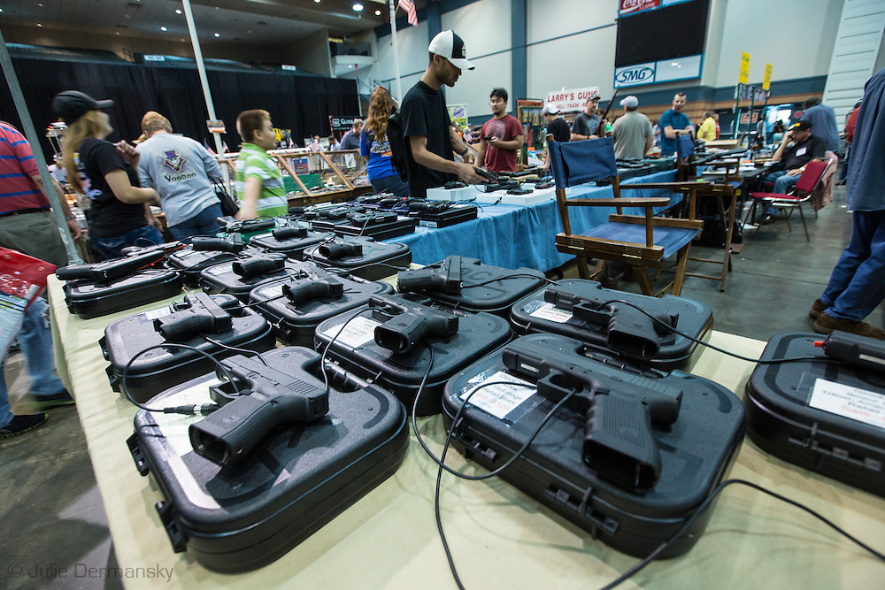 December 16th, Handguns on display included a Glock 9-mm 22 handgun, one of the types of guns found on Adam Lanza after his killing spree, at a <br /> gun show at the Pontchartrain Center in Kenner Louisiana held by Great Southern Gun and Knife Shows L.L. C. Gun sales have increased since the school shooting massacre in Sandy Hook Connecticut, especially AR 15s  ( one of the guns used by Adam Lanza, the killer) as gun owners fear new legislature will soon regulate sales of such guns.