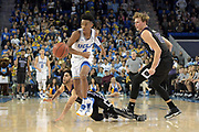 Nov 15, 2017; Los Angeles, CA, USA; UCLA Bruins guard Jaylen Hands (4) dribbles down court with Central Arkansas Bears guard Jordan Howard (1) and center Hayden Koval (15) in pursuit in the final seconds of regulation during a NCAA basketball at Pauley Pavilion. UCLA defeated Central Arkansas 106-101 in overtime.