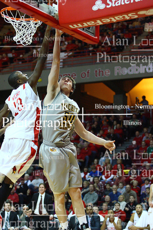 22 February 2012:  Jake White's shot is challenged by John Wilkins during an NCAA Missouri Valley Conference mens basketball game between the Wichita State Shockers and the Illinois State Redbirds in Redbird Arena, Normal IL
