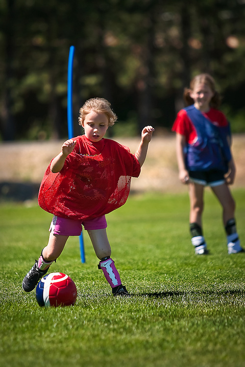 Playing fierce defense, Isabelle James traps the balls and makes a pass to one of her teammates during a friendly game at the Skyhawks Soccer Camp Friday afternoon.