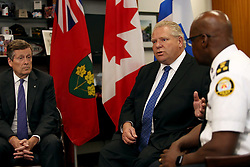 Toronto mayor John Tory, left, and police chief Mark Saunders, right, look on as Ontario Premier Doug Ford speaks during an intergovernmental meeting in the wake of a mass shooting which happened in Toronto Sunday night, at City Hall in Toronto, ON, Canada, on Monday, July 23, 2018. Photo by Nick Kozak/CP/ABACAPRESS.COM