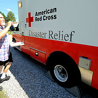 Joe Lukas, Red Cross Board Member and Director of Operations Services, checks lighting on the Disaster Relief Vehicle, ERV 1138, as he goes through a check list for the truck to have it ready in case it is needed once Hurricane Florence hits the east coast.