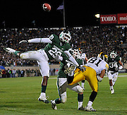 Oct 24, 2009; East Lansing, MI, USA; Michigan State cornerback Chris L. Rucker (29) linebacker Eric Gordon (43) and Iowa tight end Tony Moeaki (81) leap for a pass during the fourth quarter at Spartan Stadium.  Mandatory Credit: Jason Miller-US PRESSWIRE