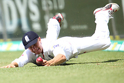 © Licensed to London News Pictures. 05/01/2014. Scott Borthwick dives to field the ball during day 3 of the 5th Ashes Test Match between Australia Vs England at the SCG on 5 January, 2013 in Melbourne, Australia. Photo credit : Asanka Brendon Ratnayake/LNP