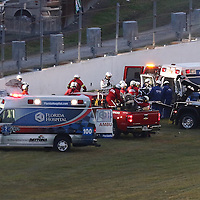 Kyle Busch is laid on a stretcher and placed into the ambulance after a crash into the wall during the Alert Today Florida 300 XFinity Series race at Daytona International Speedway on Saturday, February 21, 2015 in Daytona Beach, Florida.  (AP Photo/Alex Menendez)