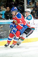 KELOWNA, CANADA, FEBRUARY 15: Ashton Sautner #5 of the Edmonton OIl Kings is checked by Cody Chikie #14 of the Kelowna Rockets at the Kelowna Rockets on February 15, 2012 at Prospera Place in Kelowna, British Columbia, Canada (Photo by Marissa Baecker/Shoot the Breeze) *** Local Caption ***