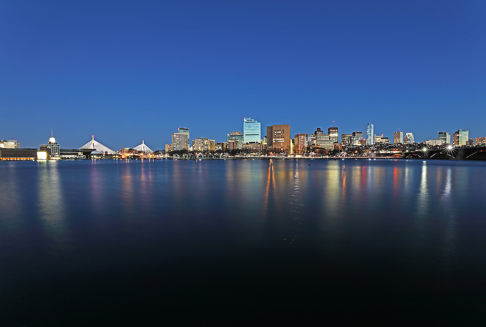 Boston night photography showing familiar Boston landmarks at twilight. From left to right one can see the Museum of Science, the Zakim Bridge or Bunker Hill Bridge, Massachusetts General Hospital in the West End, Beacon Hill with its iconic Massachusetts State House, Longfellow Bridge and the newly constructed Millennium Tower in Downtown Crossing. Boston skyline photos are available as museum quality photography prints, canvas prints, acrylic prints, wood prints or metal prints. Fine art prints may be framed and matted to the individual liking and decorating needs:<br />