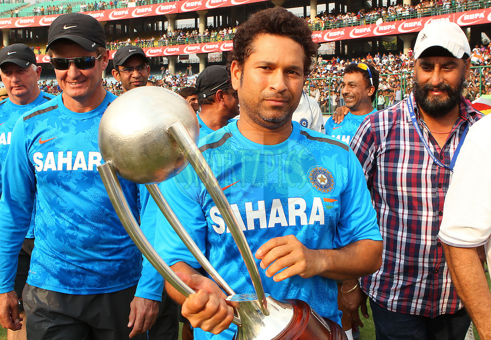 Sachin Tendulkar of India with the Border Gavaskar trophy during day 3 of the 4th Test Match between India and Australia held at the Feroz Shah Kotla stadium in Delhi on the 24th March 2013..Photo by Ron Gaunt/BCCI/SPORTZPICS ..Use of this image is subject to the terms and conditions as outlined by the BCCI. These terms can be found by following this link:..http://www.sportzpics.co.za/image/I0000SoRagM2cIEc