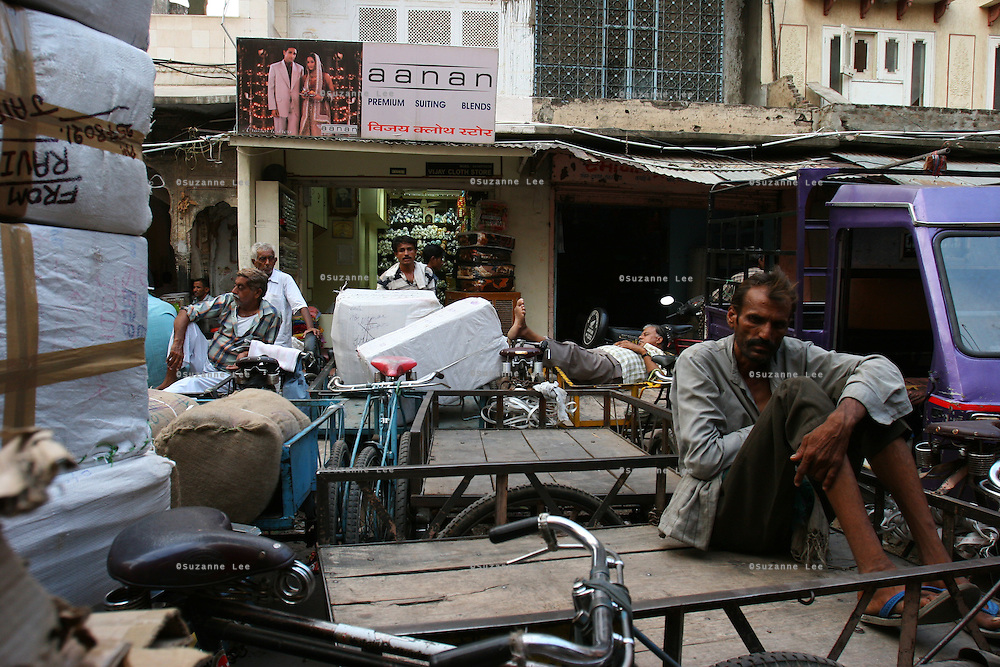 Labourers have their rest on their carts and rickshaws in the back alleys of the market in the pink city of Jaipur, Rajasthan, India..Photo by Suzanne Lee