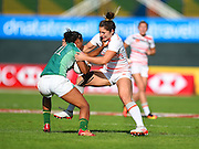 England's Amy Wilson-Hardy lays a tackle on Brazil's Haline Scatrut during the Emirates Dubai rugby sevens match between England and Brazil  at the Sevens Stadium, Al Ain Road, United Arab Emirates on 1 December 2016. Photo by Ian  Muir.*** during the Emirates Dubai rugby sevens match between *** and ***  at the Sevens Stadium, Al Ain Road, United Arab Emirates on 1 December 2016. Photo by Ian  Muir.