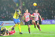 Dagenham & Redbridge's Ayo Obileye and Exeter City's Tom Nichols during the Sky Bet League 2 match between Exeter City and Dagenham and Redbridge at St James' Park, Exeter, England on 2 January 2016. Photo by Graham Hunt.