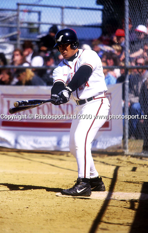 Taifau Matai picks the bat to use - New Zealand Black Sox v Australia, Softball in Invercargill, 25 November 2000. Photo: Sandra Teddy/Photosport.co.nz