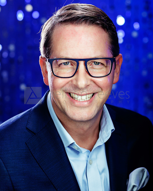 Modern corporate headshot for tech company shot against electric blue starry background