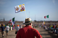 A pilgrim wears a flag while waiting for Pope Pope Benedict XVI at the base of Cuatro Vientos, eight kilometres (five miles) southwest of Madrid on August 21, 2011.The pilgrims spent the night in the open air at the base of Cuatro Vientos, eight kilometres (five miles) southwest of Madrid, where Pope Benedict XVI celebrates the closing mass of the August 16-21 youth festival on Sunday morning