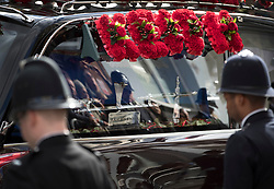 © Licensed to London News Pictures. 10/04/2017. London, UK. Officers line the route as the funeral cortege carrying the coffin of policeman Keith Palmer leaves from Southwark after a service was held at the cathedral. PC Palmer was murdered just inside the main gates of Parliament by Westminster attacker Khalid Masood - an attack in which he also killed four people on Westminster Bridge. PC Palmer's funeral will take place at Southwark Cathedral today. Photo credit: Peter Macdiarmid/LNP