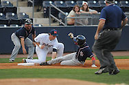 Ole Miss' Preston Overbey (1) tags out Samford's Phillip Ervin, who was trying for a triple, in the first inning at Oxford-University Stadium in Oxford, Miss. on Tuesday, March 22, 2011.