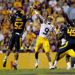 Sep 25, 2010; Baton Rouge, LA, USA; LSU Tigers quarterback Jordan Jefferson (9) throws as West Virginia Mountaineers linebacker Najee Goode (52) pressures during the second half at Tiger Stadium. LSU defeated West Virginia 20-14.  Mandatory Credit: Derick E. Hingle