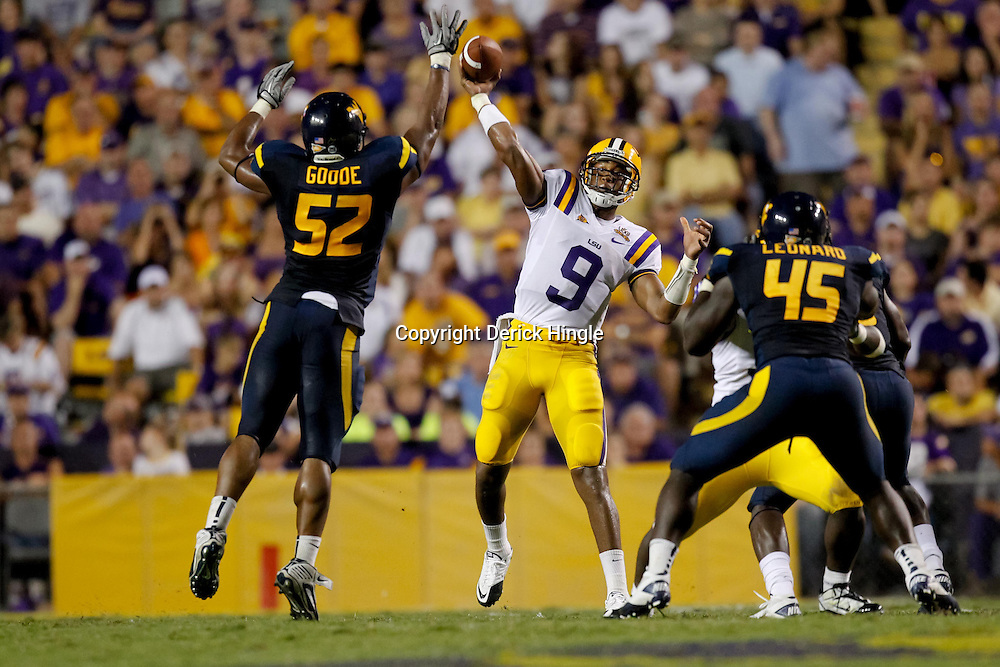 Sep 25, 2010; Baton Rouge, LA, USA; LSU Tigers quarterback Jordan Jefferson (9) throws as West Virginia Mountaineers linebacker Najee Goode (52) pressures during the second half at Tiger Stadium. LSU defeated West Virginia 20-14.  Mandatory Credit: Derick E. Hingle