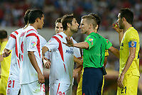 Referee Alejandro J. Henrandez calls for calm during the match between Sevilla FC and Villarreal day 9 spanish  BBVA League 2014-2015 day 5, played at Sanchez Pizjuan stadium in Seville, Spain. (PHOTO: CARLOS BOUZA / BOUZA PRESS / ALTER PHOTOS)