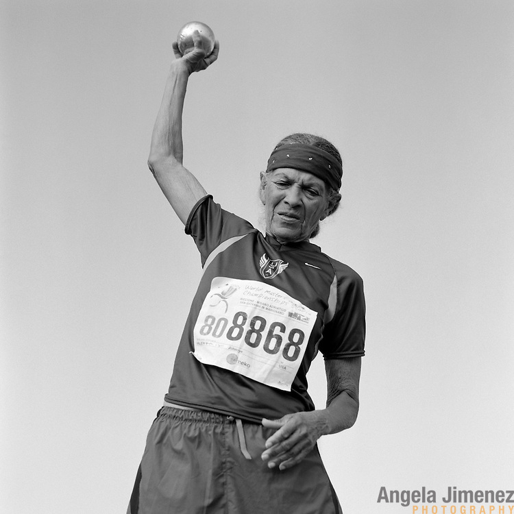 82-year-old senior athlete Johnnye Valien, of Los Angeles, California, is photographed competing in the 80-84 age bracket women's shot put during the 2007 World Masters Championships Stadia (track and field competition) at Misano Adriatico Stadium in Misano Adriatico, Italy on September 7, 2007. ..9,000 male and female athletes over the age of 35 from 90 countries competed in two weeks of track and field events at the 17th annual event. The event is run by  the World Association of Masters Athletes, the organization designated by the IAAF (The International Association of Athletics Federations) to conduct the worldwide sport of masters athletics. The organization runs competitions and maintains record standings in the 5-year increment age divisions.  ...