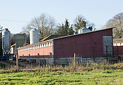 Exterior of indoor pig unit in farmyard at Sutton, Suffolk, England, UK