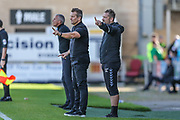 Forest Green Rovers manager, Mark Cooper and Forest Green Rovers assistant manager, Scott Lindsey during the EFL Sky Bet League 2 match between Northampton Town and Forest Green Rovers at Sixfields Stadium, Northampton, England on 13 October 2018.