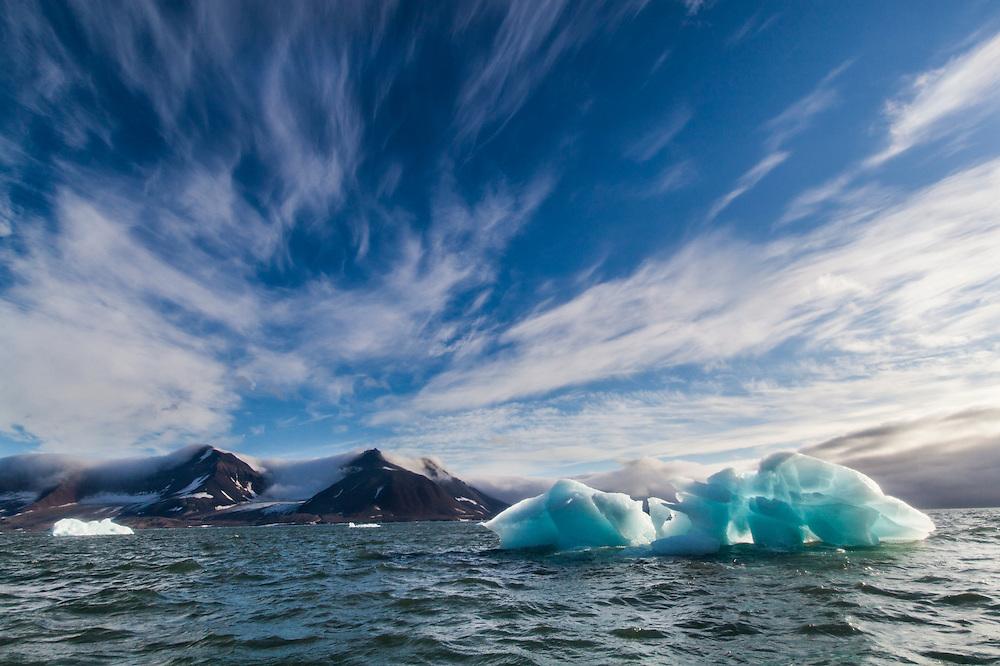 A large backlit iceberg at the entrance to Bergerbukta, Hornsund, Svalbard.
