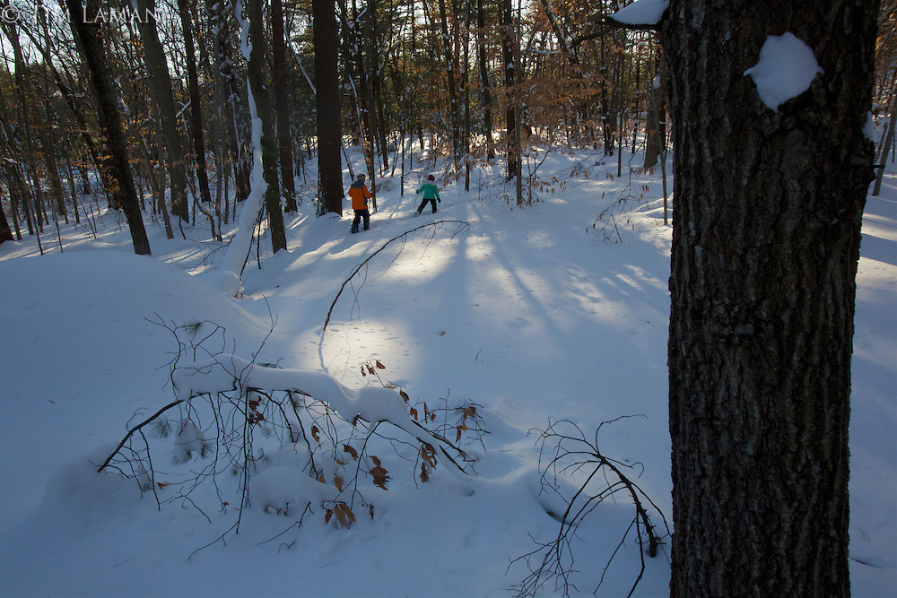 Russell (age 12) and Jessica (age 9 ) Laman cross country skiing in the New England woods.