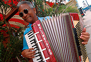 CUBA, HAVANA (HABANA VIEJA) portrait of man playing an accordion