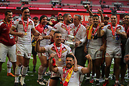 Catalans Dragons celebrate winning the 2018 Ladbrokes Challenge Cup beating Warrington Wolves 20-14  during the Ladbrokes Challenge Cup Final match at Wembley Stadium, London<br /> Picture by Stephen Gaunt/Focus Images Ltd +447904 833202<br /> 25/08/2018