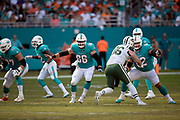 Miami Dolphins offensive guard Ted Larsen (62) and Miami Dolphins center Travis Swanson (66) block New York Jets defensive end Henry Anderson (96) during the NFL week 9 regular season football game against the New York Jets on Sunday, Nov. 4, 2018 in Miami Gardens, Fla. The Dolphins won the game 13-6. (©Paul Anthony Spinelli)