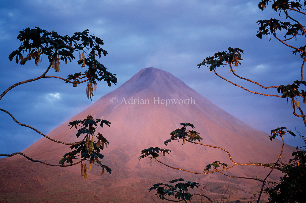 Arenal Volcano at dusk. Costa Rica. The volcano turned red for a few moments just before the sun set. <br />