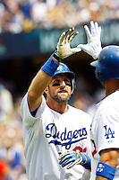 22 August 2009:#23 Casey Blake high fives a player after hitting a home run in the fourth inning  during the MLB National League Chicago Cubs 2-0 loss to the Los Angeles Dodgers at Chavez Ravine.