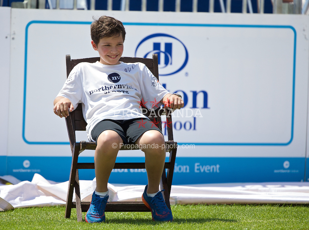 LIVERPOOL, ENGLAND - Sunday, June 22, 2014: A young line judge during Day Four of the Liverpool Hope University International Tennis Tournament at Liverpool Cricket Club. (Pic by David Rawcliffe/Propaganda)