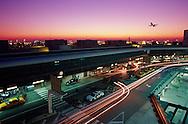 Plane and car traffic at Miami International Airport, Miami, Florida.