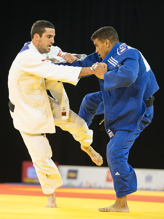 Alejandro Clara (L) and Magdeil Estrada of Cuba vie for position during their gold medal contest in the men's judo 73kg class at the 2015 Pan American Games in Toronto, Canada, July 12,  2015.   AFP PHOTO/GEOFF ROBINS