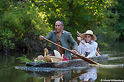 Powhatan Indians with a dugout canoe.