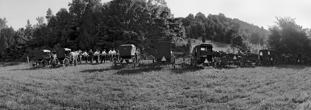 "An old-order Mennonite community was established in 1976 by several families who relocated from Pennsylvania to the small town of Liberty in Casey County, Kentucky.  The community allowed me to spend several days there in June of 1980 photographing them with the only stipulation that I couldn't ""pose"" any photos.   They worked their fields and gardens, did other chores. The whole community went to church on Sunday using an old farmhouse as their place of worship. ..Buggy parking lot."