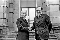Brian Faulkner, chief minister, N Ireland Executive (left), meets the newly-appointed Secretary of State for N Ireland, Merlyn Rees on 6 March 1974. They are pictured on the steps of Stormont Castle, which was where cabinet meetings were held. 197403060023.<br /> <br /> Copyright Image from Victor Patterson, 54 Dorchester Park, <br /> Belfast, UK, BT9 6RJ<br /> <br /> t1: +44 28 9066 1296 (from Rep of Ireland 048 9066 1296)<br /> t2: +44 28 9002 2446 (from Rep of Ireland 048 9002 2446)<br /> m: +44 7802 353836<br /> <br /> e1: victorpatterson@me.com<br /> e2: victorpatterson@gmail.com<br /> www.victorpatterson.com<br /> <br /> Please see my Terms and Conditions of Use at www.victorpatterson.com. It is IMPORTANT that you familiarise yourself with them.<br /> <br /> Images used on the Internet must be visibly watermarked i.e. © Victor Patterson<br /> within the body of the image and copyright metadata must not be deleted. Images <br /> used on the Internet have a size restriction of 4kbs and will be chargeable at current<br />  NUJ rates unless agreed otherwise.<br /> <br /> This image is only available for the use of the download recipient i.e. television station, newspaper, magazine, book publisher, etc, and must not be passed on to any third <br /> party. It is also downloaded on condition that each and every usage is notified within 7 days to victorpatterson@me.com<br /> <br /> The right of Victor Patterson to be identified as the author is asserted in accordance with The Copyright Designs And Patents Act (1988). All moral rights are asserted.