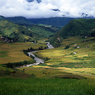 River runs through a green valley of Lao Cai Province south-east of Sapa, Vietnam, Southeast Asia
