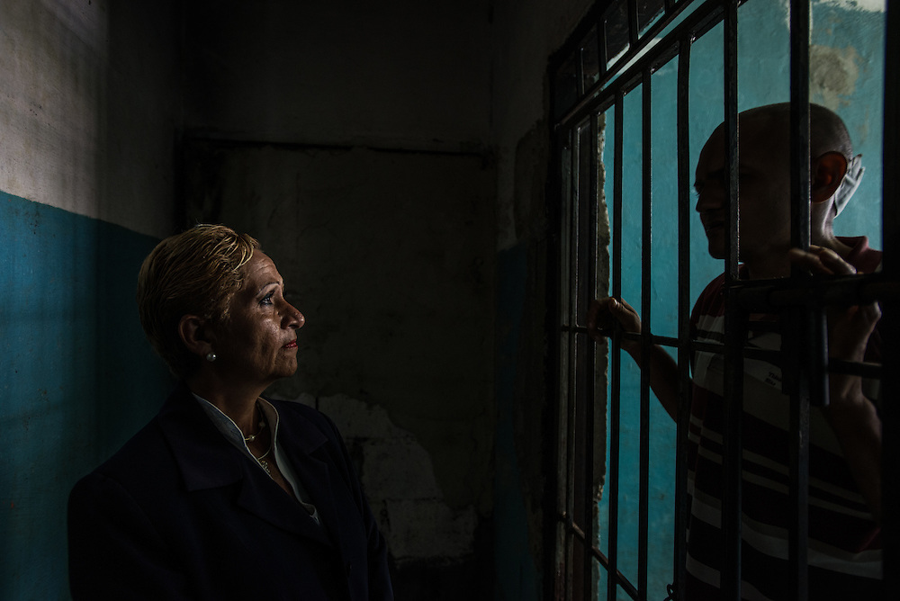 BARQUISIMETO, VENEZUELA - JULY 28, 2016: Schizophrenic patient, Emeregildo Aranguren, pleads with head nurse, &Eacute;vila Garc&iacute;a<br />