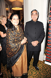 The Indian High Commissioner H.E. Mr. Nalin Surie and his wife at a gala dinner in celebration of 80 years since the first Foyles Literary Luncheon, held in The Ball Room, Grosvenor House Hotel, Park Lane, London on 21st October 2010.