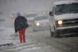 Philadelphia, PA, USA - February 20, 2019: Pedestrians brace the weather as Winter storm Petra brings several inches of snow to Philadelphia, PA, on February 20, 2019. The city is expected to receive five inches of snowfall before changing over to sleet.