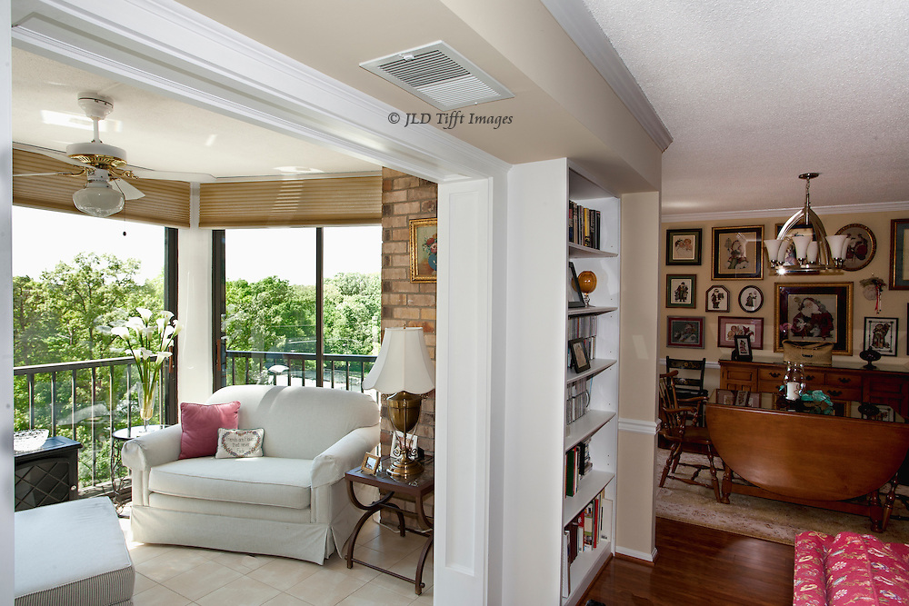 Interior of an apartment residence in suburban Washington DC, showing sunroom, dining room, and library.