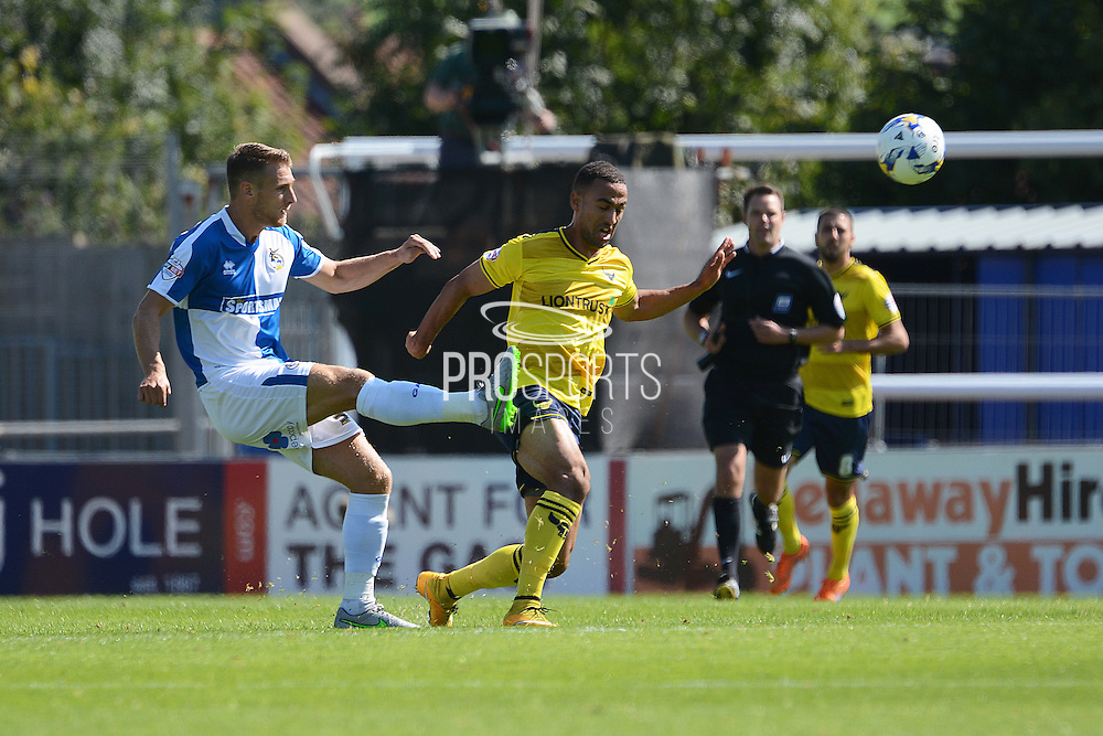 Lee Brown clears the ball from Kemar Roofe during the Sky Bet League 2 match between Bristol Rovers and Oxford United at the Memorial Stadium, Bristol, England on 6 September 2015. Photo by Alan Franklin.